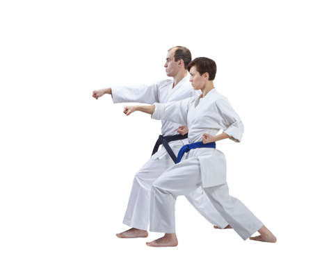 Sister and brother are beating a punch arm on a white background isolated