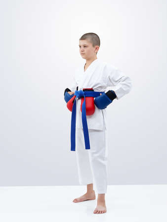 Athlete stands with a blue belt and overlays of red and blue