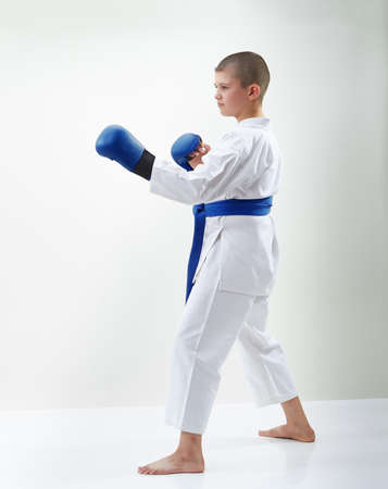 Karateka boy with blue overlays on the hands is in the rack karate Stock Photo