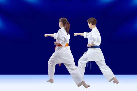 Young sportswomen train a punch hand