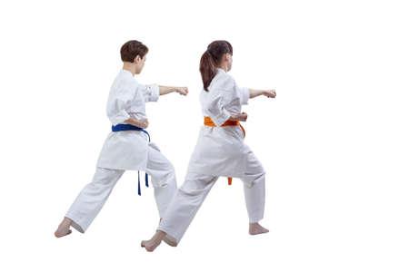 Friends sportswomen are training kick against white background Stock Photo