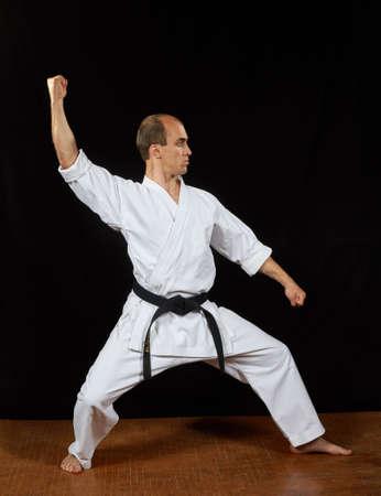 Master in karategi trains blocks Stock Photo