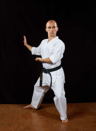 Karate athlete trains the blocks with his hands Kaderov Standard-Bild