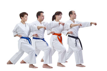 Sportsmen with different colors of belts beat punch arm on a white background