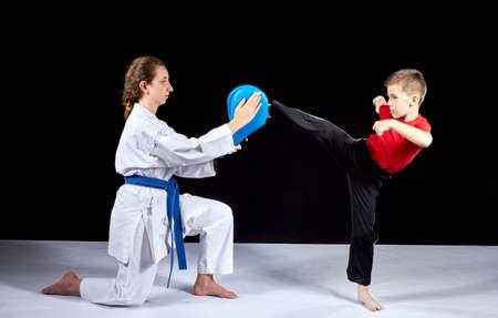 Circular kick kicking boy is beating on the simulator Stock Photo