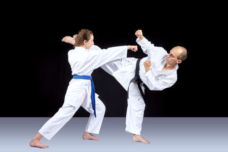 Kick leg and striking with a hand are trained by athletes Stock Photo