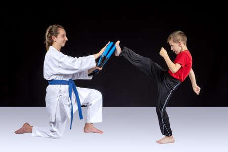 Small athlete trains a kick on the simulator Reklamní fotografie