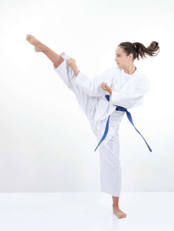 High kick kicking girl in karategi 版權商用圖片