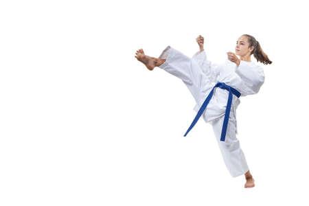 On a white background the sportswoman beats a kick leg Stock Photo