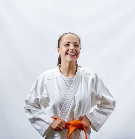A cheerful sportswoman in karategi