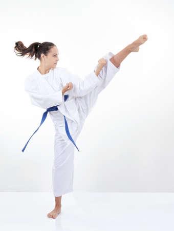 Athlete in karategi beats foot