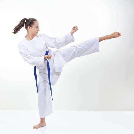 Adult sportswoman beats kick