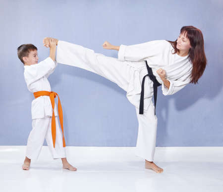 Sports family are training kick leg Banco de Imagens - 87234815
