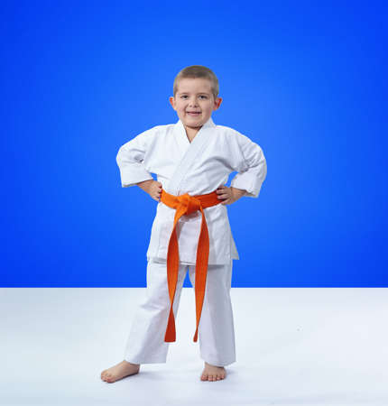 Sportsman in karategi on a blue background