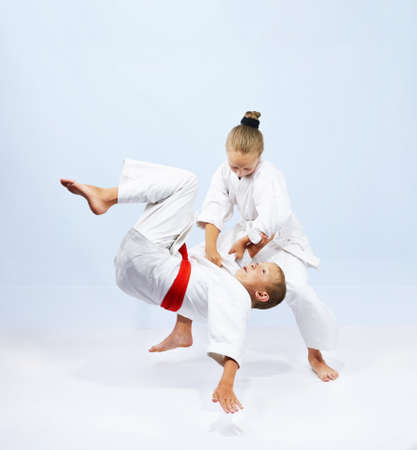 The girl with a white belt does judo throw Stock Photo