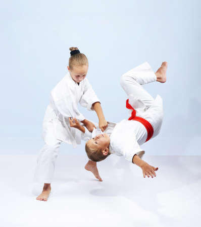 Judo throws children are training in judogi