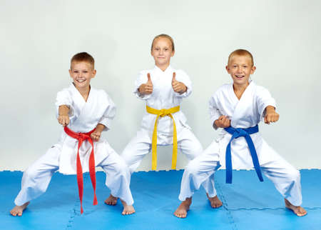 Young children are hitting punch and shows finger super Stock Photo