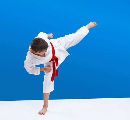 In karategi boy athlete beats kicking