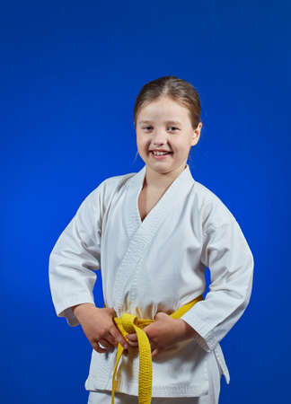 Cheerful sportswoman on a blue background