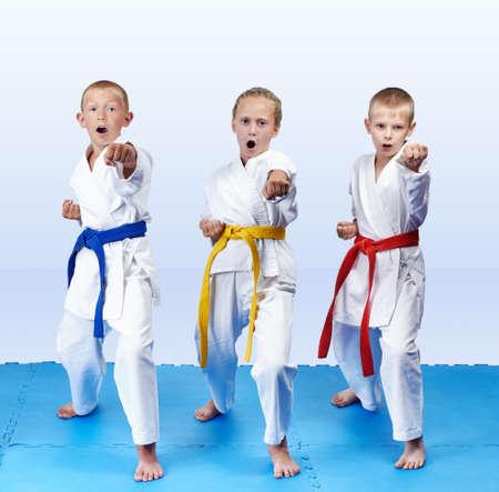Punch hand are hitting three karateka Stock Photo