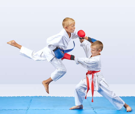 Punch arm in the jump and block are training boys in karategi
