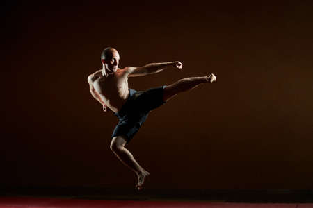 One athlete trains a kick in a jump
