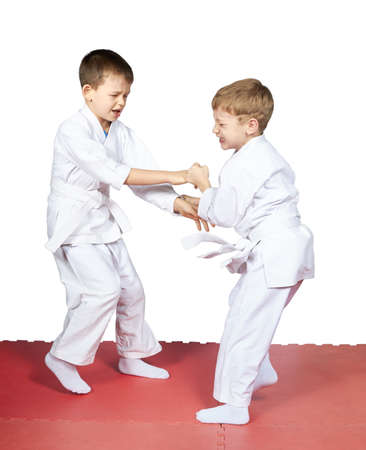 Children trained judo sparring
