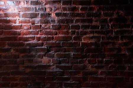 White light on a dark brick wall Archivio Fotografico