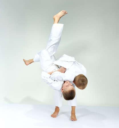 Boys are training judo throws Stock Photo