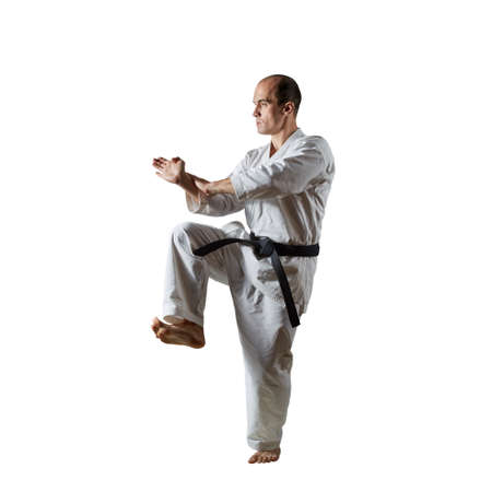 Active athlete performs formal exercises on an isolated white background.