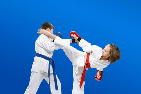 With overlays on the hands the children are beating karate blows Banco de Imagens