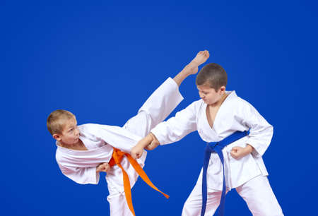 Boys are trained karate blows