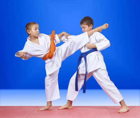 In karategi sportsmen are training karate blows