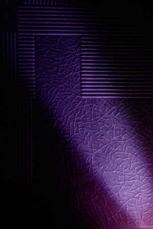 Violet diagonal ray of light on a background with a diverse pattern