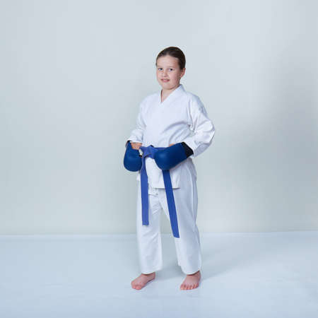 Beautiful athlete with blue overlays on hands and blue belt