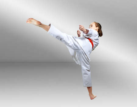 Girl beats a kick on the gradient background