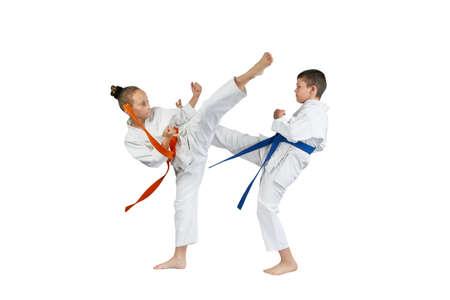 Blows legs are beating sportsmens in karategi Stock Photo