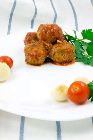 marinara sauce: Meatballs with tomato sauce on white plate