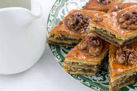 Honey baklava on the saucer with oriental design