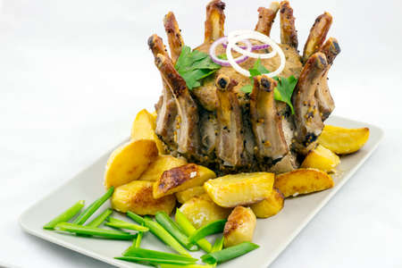 Crown roast of pork with potato wedges Stock Photo - 72295201