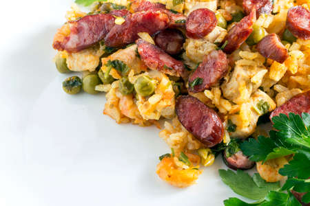 Peasant paella in the white plate