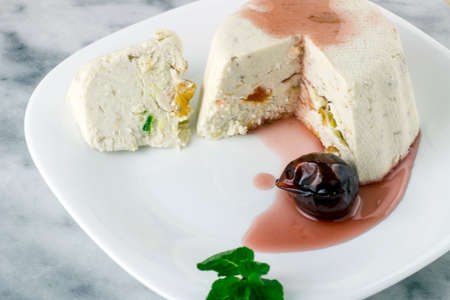 Curd cheese pudding with walnuts, raising and dried fruits Stock Photo