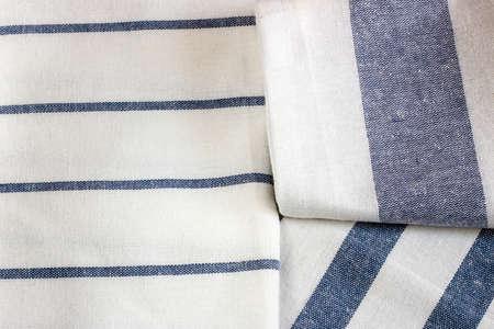 cloth napkins on light wood background