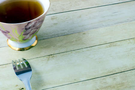 Cup of tea on light wood background