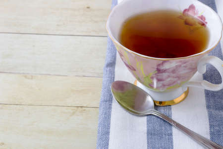 Cup of tea with napkin on light wood background Stock Photo - 72552997