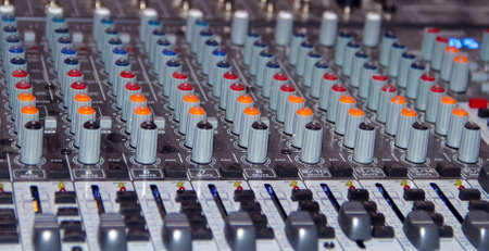 Large mixing console shot close-up during operation