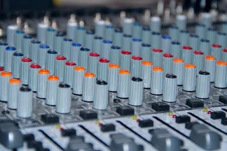 Mixing console shot in studio closeup