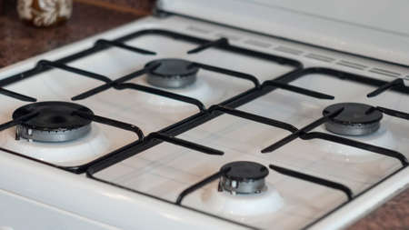 Clean and neat white gas stove