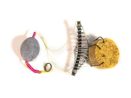 Fishing sinkers feeder hooks on a white background
