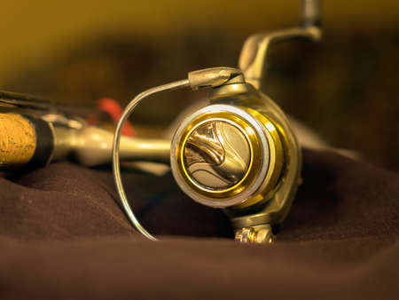 Golden fishing reels on the rod Stock Photo